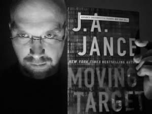 "Doug Dangler with JA Jance's book ""Moving Target"""