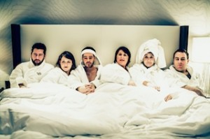 Image of Second City touring cast in bed